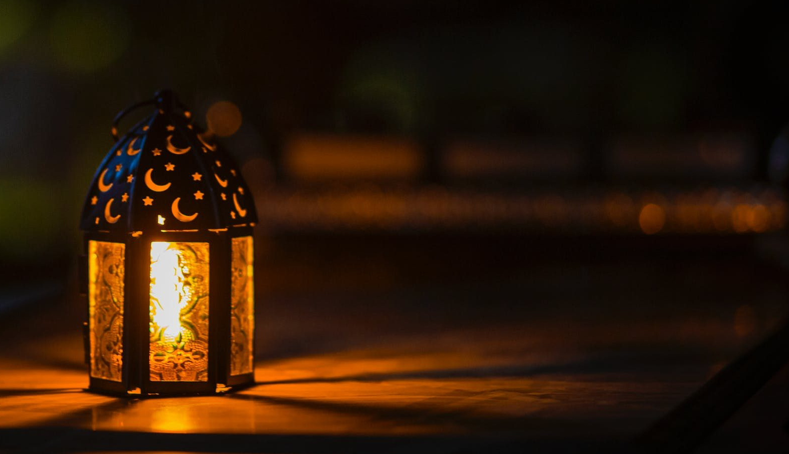 photo of ramadan light on top of table
